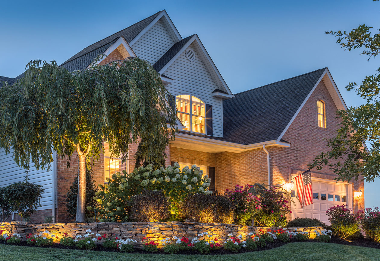 The glow from Trex Landscape Lighting adds a sophisticated ambiance to your outdoor space